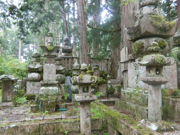 moss covered stupa graves on mount koya