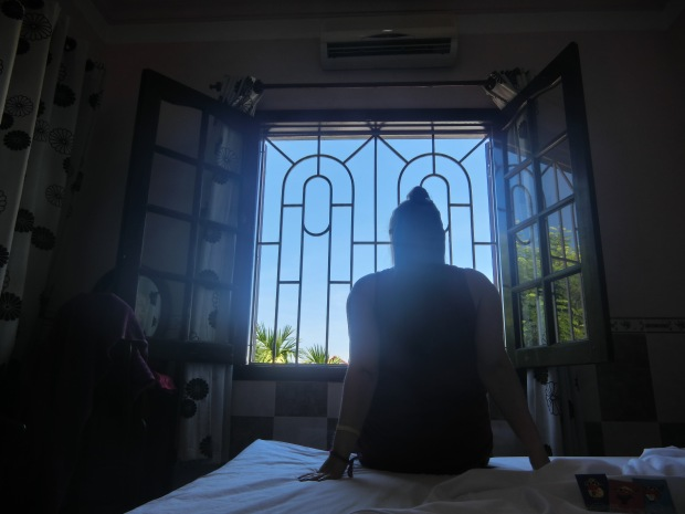 hoi an vietnam hotel room window girl sillouhette